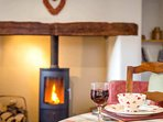 Enjoy a glass of wine by the fire!