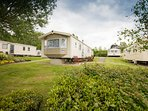 Our caravan on its spacious pitch at Combe Haven