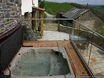 The luxury hot y=tub has commanding views of Exmoor and the valley below yet is very private