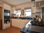 Kitchen with double oven and microwave, dishwasher and gas hob