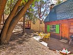 Featuring a private patio with a charming patio set and charcoal grill, this cabin will be your perfect homebase for...