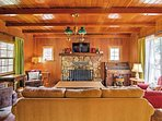 Cuddle up on the living room couches while relaxing in the warmth of the wood-burning fire.
