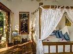 Queen bedroom with beautiful decor.