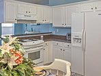 This cheery kitchen comes fully equipped with all the necessary cooking appliances