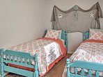 The little ones in your travel party will love this vibrantly-hued bedroom.
