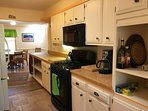 Complete up-dated kitchen with dishes, stove, refrigerator, dishwasher, cookware, coffee-maker,