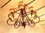 The hand made metal and stained glass chandelier.