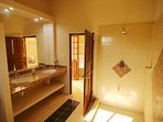 The in suite bath featuring nice tiled shower, beautiful talavera tilled double vanity.