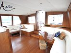 Beautiful teak crafted 360 degree indoor pilothouse. State of the art navigation systems