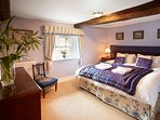 The Threlkeld Bedroom 6' double bed, which can convert to single beds.