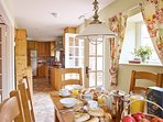 The fully equipped kitchen houses modern appliances and all the accessories of an everyday home.