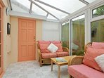 Sunny conservatory off the lounge and giving access to enclosed garden