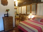 Room #6 at Casitas Kinsol - A small room with one full-size bed and a kitchenette