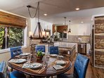 Main Level | Dining- Seating for 6. Mountain theme settings, stem and flatware