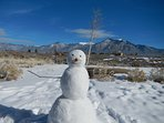 Make your own snowman, with the mountains as your backdrop