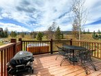 Step out onto the back deck and grill up a meal on the provided gas grill.