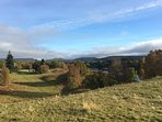 Stunning views from this spot, near our back door, across to Cairngorm mountains.  The dog loves it.
