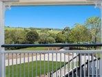 Front veranda view of beautiful farmland.