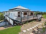 Large back veranda, beautiful rock wall garden beds and plenty of room to entertain.