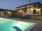 Villa and pool in night time