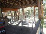 Back deck area with barbecue, ping pong, and picnic table