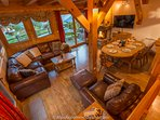 Spacious living and dining area with log fire and great views.