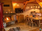 Relax in the comfortable living area, in front of the warming log fire.