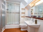 Bathroom with roomy shower and two heated towel rails