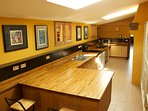 the kitchen has oak work tops and is large enough for several cooks