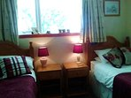 Pine headboards and bedside tables with drawers. All carpeted. 2 pillows for each person staying.