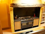 the range cooker is tucked under a 300 year old oak beam
