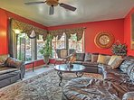 Look forward to kicking back and relaxing on the couches in this living area.