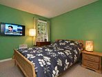 Master bedroom with Queen bed, new linens and wall mounted TV