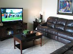 HD TV with surround sound and Reclining Sofas