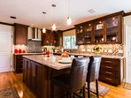 Luxurious gourmet kitchen, state of the art appliances, huge island seats 2.