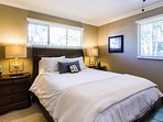 Master bedroom offers queen pillow top mattress and white fine cotton linens.