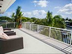 Third floor, master suite, private balcony overlooking the pool and waterway