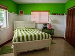 Third guest bedroom with a queen size bed, 2 large closets, on the first floor with tropical views
