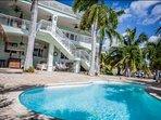 Refreshing lagoon pool overlooking the waterway and swaying palms