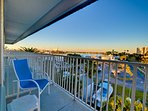 Enjoy views of the harbor, swimming pool, and beach community