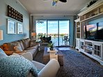 Large flat screen and water views in living room