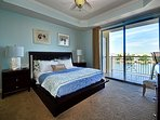 Master Bedroom with water view and balcony access