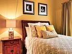 Guest bedroom one with queen size bed