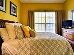 Cozy guest bedroom with flat screen TV