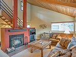 Lounge on the cozy couches while the wood-burning fire warms up the living area.