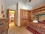 This bunk room features a twin-over-queen bunk bed and twin mattress.