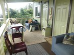 lanai with 2 pull out couches, dining table and doors to bedrooms