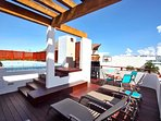 Private rooftop terrace with pool, lounge chairs, grill and shower