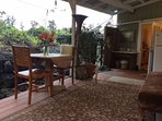 lanai with dining table overlooking the zen rock gardens & the veggie gardens