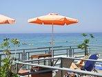 Hotel's  sundeck and beach front beach bar